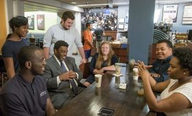 Chancellor Gilliam talking with students around a table