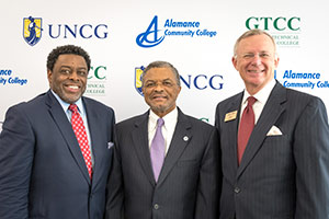 Photo of UNCG Chancellor Franklin D. Gilliam, Jr., ACC President Algie Gatewood and GTCC President Randy Parker standing together at press conference