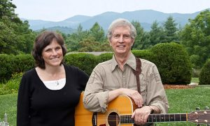 Photo of Fiona Ritchie and Doug Orr with mountains in background