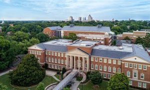 Aerial photo of UNCG's campus with downtown Greensboro in the background.