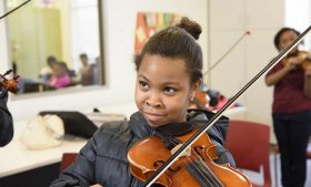 Elementary school student playing violin