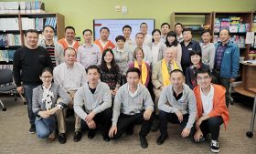 Group photo of Chinese headmasters and UNCG faculty