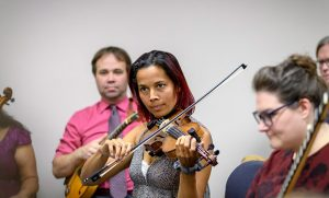 Rhiannon Giddens plays fiddle alongside students