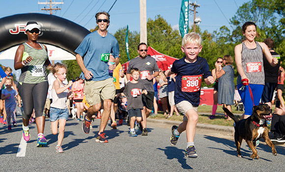 Adults and kids running race