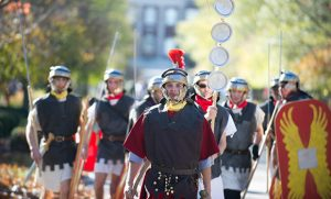 Students in costume participate in Roman military drills