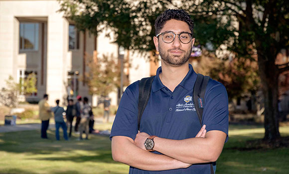 Photo of Sam Alsharif standing in front of EUC