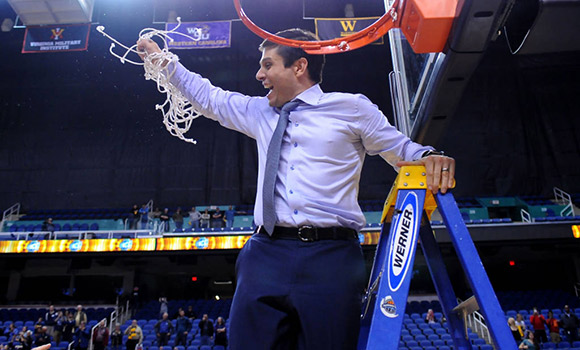 Photo of Wes Miller celebrating after cutting down the net