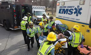 Photo of emergency responders and EMS vehicles responding to drill