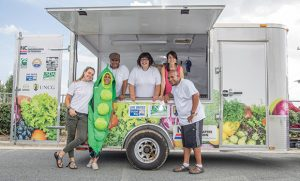 Group photo at Mobile Oasis Farmers Market