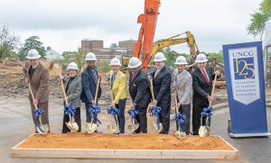 Chancellor Gilliam and state leaders hold golden shovels at the site of the official groundbreaking of the new Nursing and Instructional building.