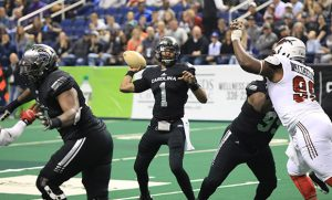 Photo of Carolina Cobras quarterback throwing a pass during a game