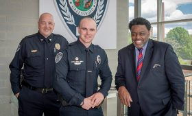 Portrait of Chief Lester, Officer Trantham and Chancellor Gilliam