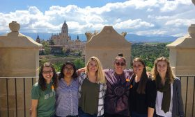 Group photo of students in Spain with view of city in background