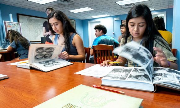 Students look through old yearbooks at the UNCG Archives