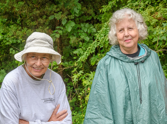 Two female professors dressed for outdoor exploration.