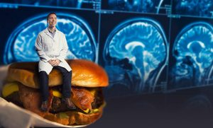 Composite image of Dr. Fordahl sitting on hamburger with brain scans in the background