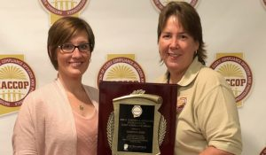 Photo of Kristi Reese being presented the award
