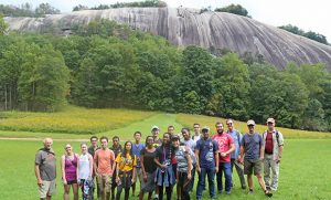 Group photo of students with Stone Mountain in the background