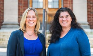 Dr. Kelly Wester and Dr. Carrie Morris smiling at the camera.