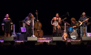 Photo of Rhiannon Giddens and her band performing on stage