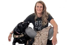 Photo of student veteran with service dog.