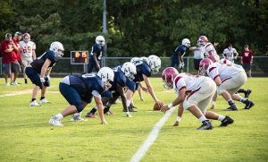 Photo of football players scrimmaging