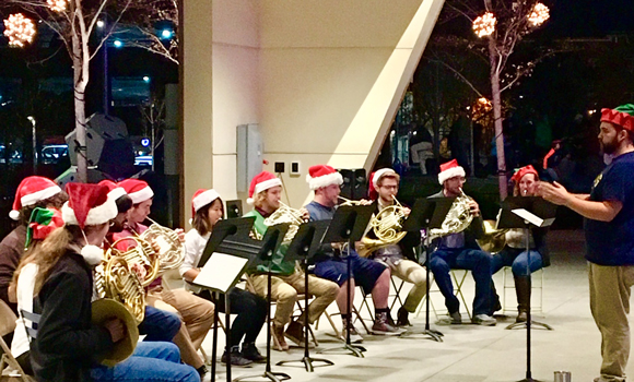 Horn choir in holiday hats