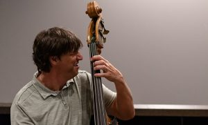 Photo of Steve Haines playing bass