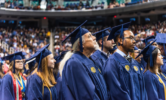 Photo of UNCG graduates during 2018 December Commencement.
