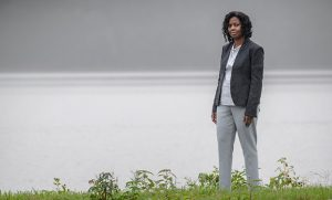 Photo of Dr. Tara Green standing at water's edge