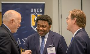 Photo of Chancellor Gilliam speaking with Leo Lambert and Vincent Price