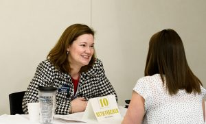 Photo of Beth Fischer speaking with a student