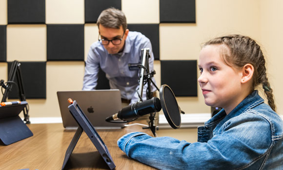 Ben Peterson with Moss Street student in podcast studio.