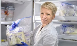 Photo of Dr. Maryanne Perrin with bags of donor milk
