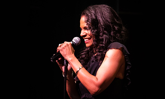 Photo of Audra McDonald singing