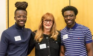 Students, brothers and entrepreneurs pose with Dianne Welsh at Entrepreneurship Everywhere event in the EUC.