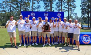 Photo of golf team posing with trophy