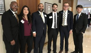 A photo of the grad students standing with NC lawmakers