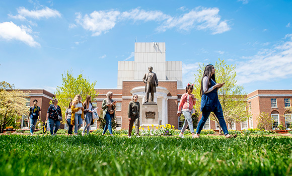 Photo of students walking in front of Jackson Library