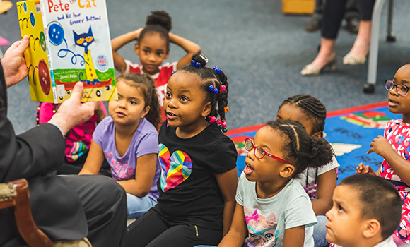 Photo of small group of students being read to