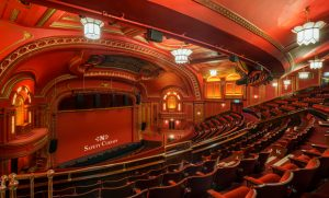 the inside of a glamourous theatre