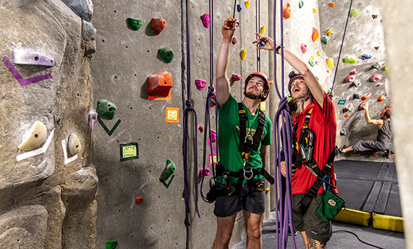 Photo of students at the rock wall