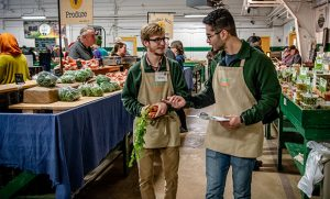 Photo of two men working at farmers market