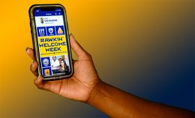 Photo of UNCG Mobile app home screen on an iPhone
