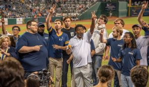 Photo of the Chancellor and others at a baseball game