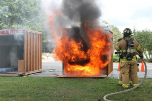 Photo of a firefighter fighting fire