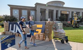 Photo of students with canned goods on campus