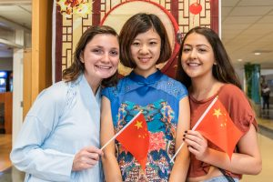 three girls with Chinese flags