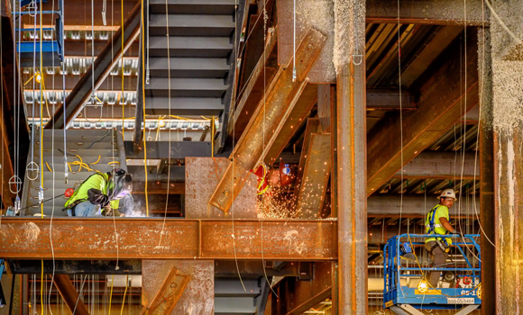 Workers continue steelwork, piping, and ventilation systems for the NIB.