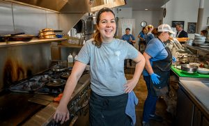 Photo of Kathryn Hubert in restaurant kitchen